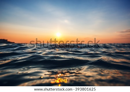 Sea wave close up, low angle view, sunrsie shot #393801625