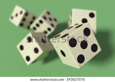 3d rendering of close-up of 3d dice falling down on green surface #393837070