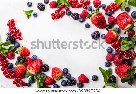 Various fresh summer berries. Top view Royalty-Free Stock Photo #393897256