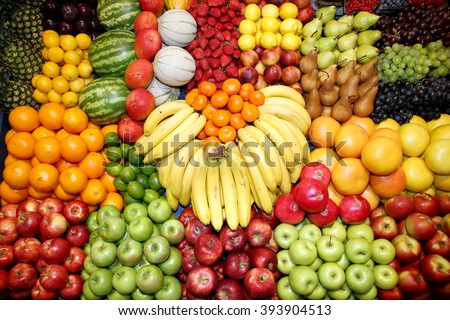 Set of freshly picked organic fruits at market stall