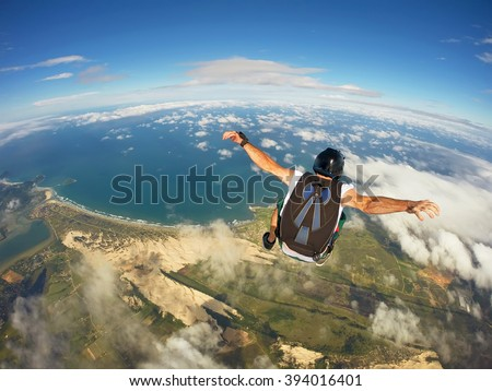 Skydiving over the beach, Santa Catarina, Brazil #394016401