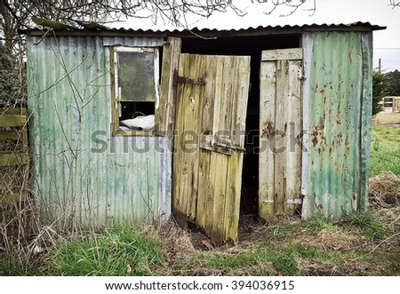 An old metal hut with a wooden door #394036915