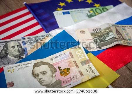 america, europe, ukraine and russia - flag and money #394061608