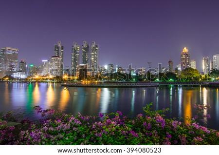 Cityscape of Benjakiti park Bangkok downtown city at night twilight evening, Bangkok Thailand #394080523