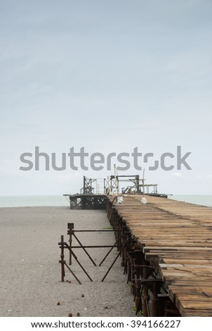 Old rusty pier in Guatemala shot in a cloudy morning. Champerico  #394166227