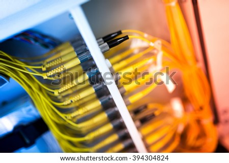 fiber optic with servers in a technology data center . #394304824
