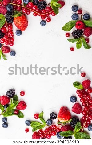 Various fresh summer berries. Top view Royalty-Free Stock Photo #394398610