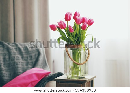 Bouquet of pink tulips in a vase, close up #394398958