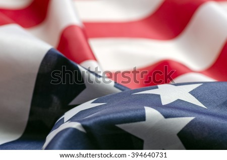 Stars and Stripes Flag background; rippling red white and blue silken American flag  Royalty-Free Stock Photo #394640731