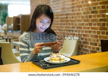 Woman take photo on her food