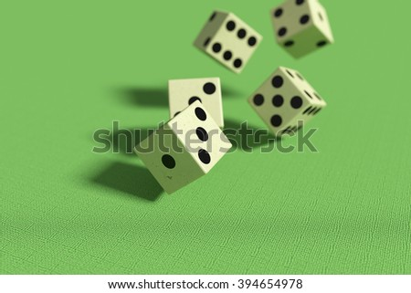 3d rendering of close-up of 3d dice falling down on green surface #394654978