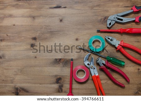 Set of tools on  wooden table #394766611