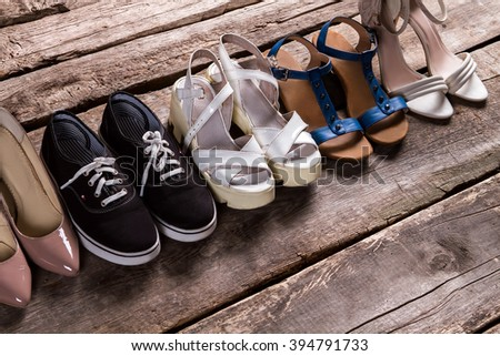 Female shoes on old floor. Tankette shoes and fabric keds. Footwear for every taste. From simplicity to luxury. #394791733