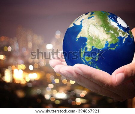 The world is on hold for the city bokeh blur background. earth social in human the hand. Businessman holding planet Earth in palm. Elements of this image furnished by NASA. #394867921