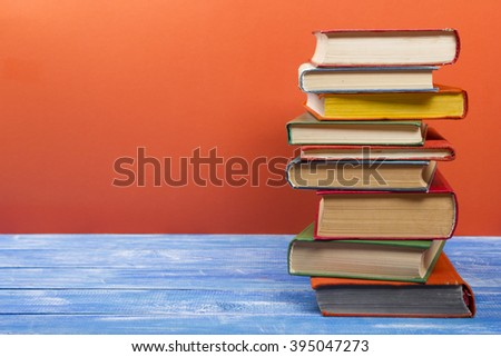 Stack of hardback books on wooden table. Back to school. Copy space for text #395047273