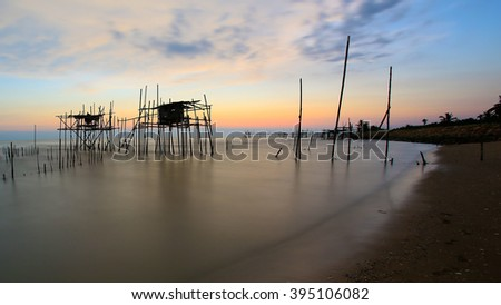 """Long exposure image of """"langgai"""" during sunset , the traditional fishing medium at Malaysia. Soft focus, noise and grain due long exposure. #395106082"""