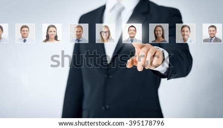 human resources, career management, recruitment and success concept - man in suit pointing to of many business people portraits Royalty-Free Stock Photo #395178796