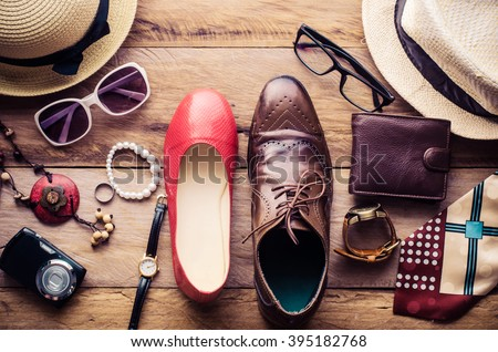 Clothing and accessories for men and women ready for travel - life style  Royalty-Free Stock Photo #395182768