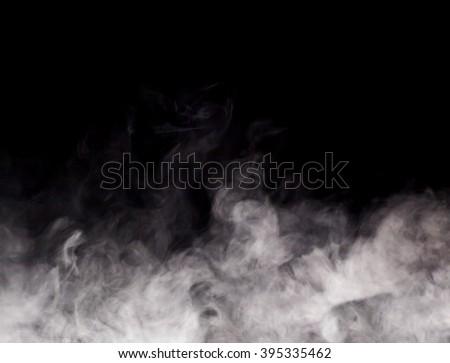 Smoke on black background Royalty-Free Stock Photo #395335462
