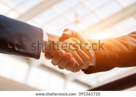 business people handshaking Royalty-Free Stock Photo #395365720