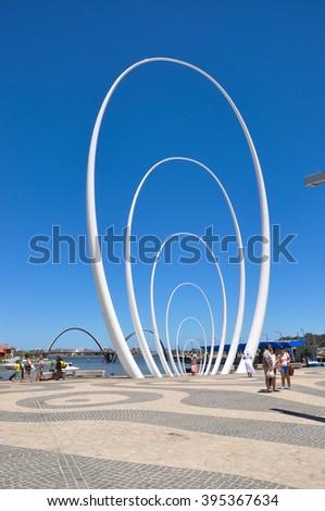 Spanda elliptical sculpture at Elizabeth Quay in Perth/Spanda/PERTH,WA,AUSTRALIA-FEBRUARY 13,2016: Spanda public sculpture by artist Christian de Vietri at Elizabeth Quay in Perth, Western Australia. #395367634