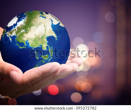 The world is on hold for the city bokeh blur background. Elements of this image furnished by NASA. #395372782