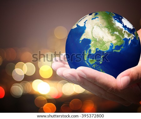 The world is on hold for the city bokeh blur background.  Elements of this image furnished by NASA. #395372800