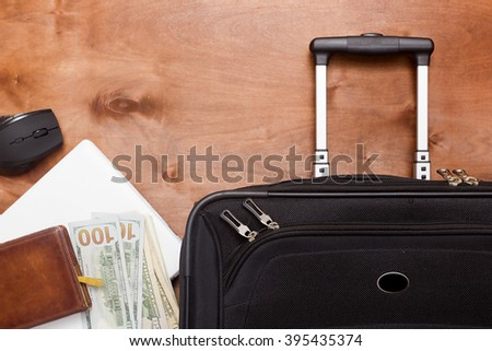 Black suitcase and luggage for a business trip on a wooden background #395435374