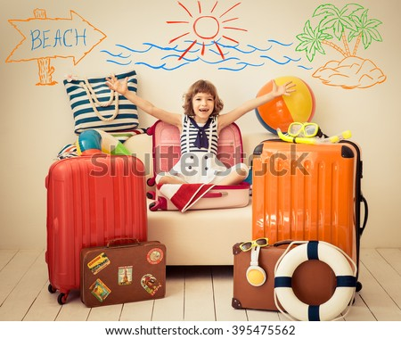 Happy child ready for a summer vacation. Kid having fun at home #395475562