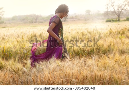 Natural beauty. Beautiful girl in a wheat field #395482048