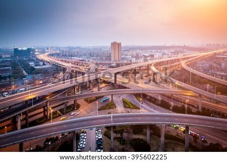 city interchange closeup at night , beautiful transport infrastructure background Royalty-Free Stock Photo #395602225