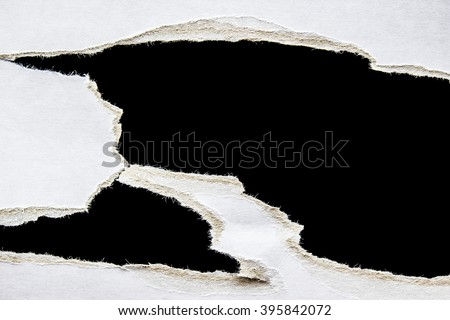 torn cardboard on black background #395842072
