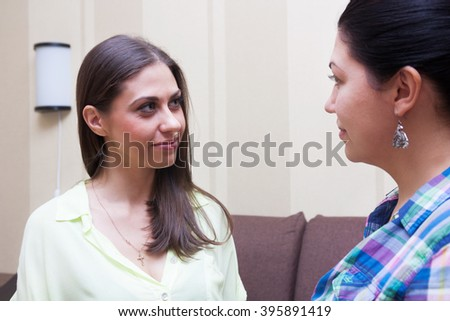 Girlfriends communicate at home on the sofa #395891419