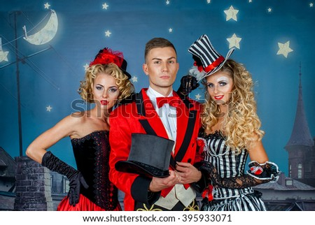 two pretty young blonde girls with men in formal retro clothes dancing Broadway style #395933071