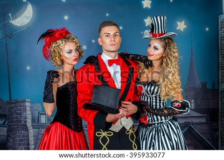 two pretty young blonde girls with men in formal retro clothes dancing Broadway style #395933077