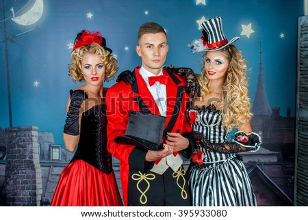 two pretty young blonde girls with men in formal retro clothes dancing Broadway style #395933080