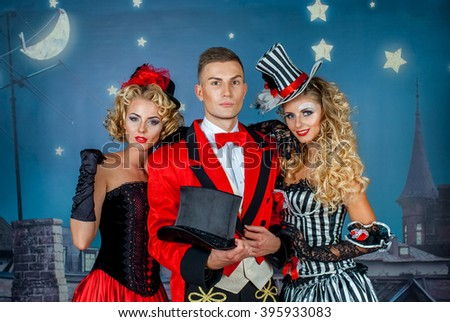 two pretty young blonde girls with men in formal retro clothes dancing Broadway style #395933083