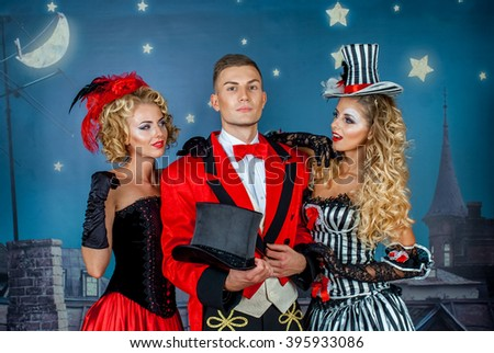 two pretty young blonde girls with men in formal retro clothes dancing Broadway style #395933086