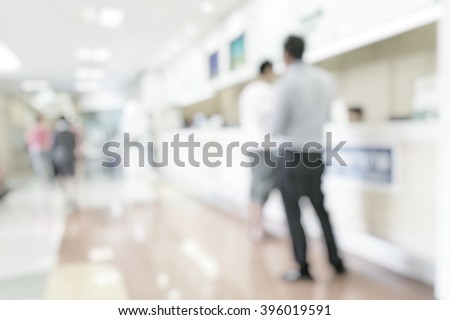 Medical blur background customer or patient service counter, office lobby, or bank business building interior inside waiting hall area  #396019591