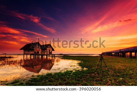 Abandoned house with evening light that photographers are drawn to photography in Thailand with bulr background.