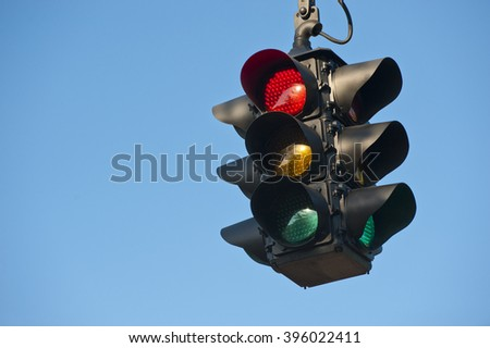 Road street red traffic light with bright blue sky background