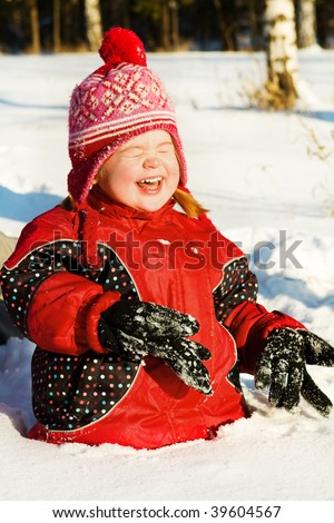 Lovely preschool girl laughing in the deep snow #39604567