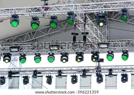 lighting equipment under roof of outdoor concert stage #396221359