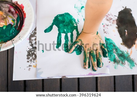 Hands of painting little boy and the table for creativity.hand kids painting.