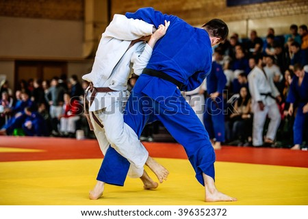battle of two fighters judo sports judo competitions Royalty-Free Stock Photo #396352372