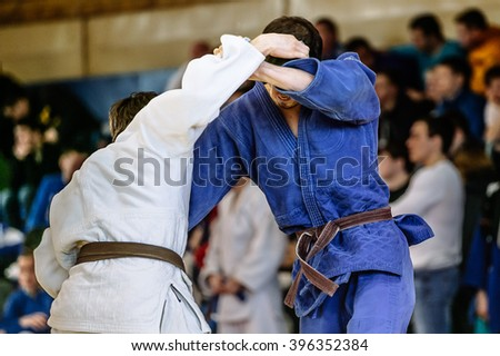 judokas fighters during fight in judo competitions Royalty-Free Stock Photo #396352384
