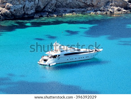 boat anchored in a bay, luxury yacht           Royalty-Free Stock Photo #396392029