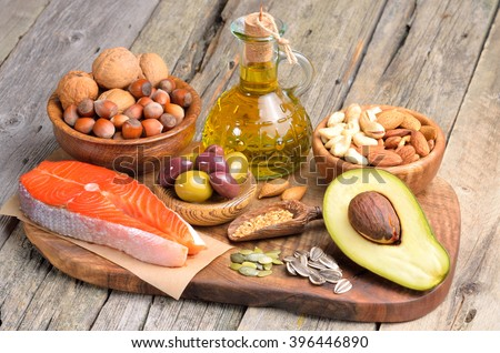 Selection of healthy fat sources on wooden background. #396446890