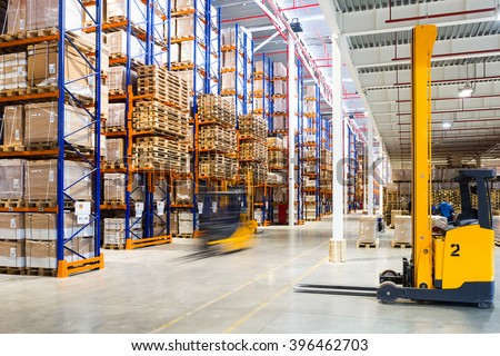Large modern warehouse with forklifts #396462703