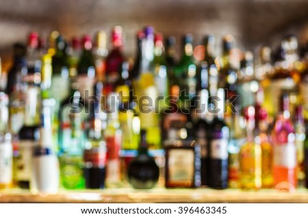 Abstract shelves with different bottles of alcohol #396463345